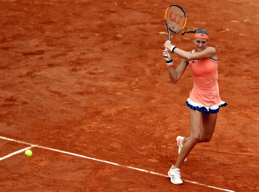 PARIS, May 28, 2018 - Kristina Mladenovic of France returns a shot during the women's singles first round match against Andrea Petkovic of Germany at the French Open Tennis Tournament 2018 in Paris, ...