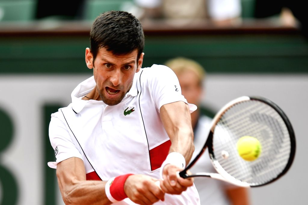 PARIS, May 28, 2018 - Novak Djokovic of Serbia returns a shot during the men's singles first round match against Rogerio Dutra Silva of Brazil at the French Open Tennis Tournament 2018 in Paris, ...