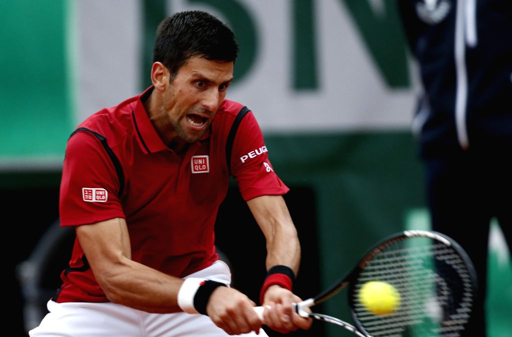PARIS, May 29, 2016 - Novak Djokovic of Serbia returns the ball during Men's Singles Round 3 against Aljaz Bedene of Britain in 2016 French Open tennis tournament at Roland Garros, in Paris, France ...