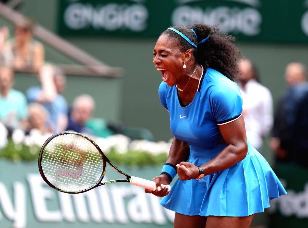 PARIS, May 29, 2016 - Serena Williams of the United States celebrates during Women's Singles Round 3 against Kristina Mladenovic of France on day 7 of 2016 French Open tennis tournament at Roland ...