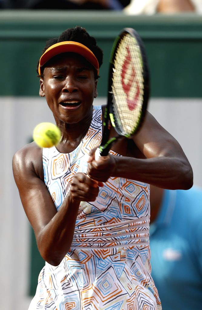 PARIS, May 29, 2016 - Venus Williams of the United States returns the ball during Women's Singles Round 3 against Alize Cornet of France on day 7 of 2016 French Open tennis tournament at Roland ...