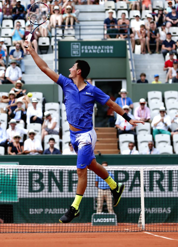 PARIS, May 29, 2017 - Bernard Tomic of Australia hits a return during the men's singles first round match against Dominic Thiem of Austria at French Open Tennis Tournament 2017 in Roland Garros, ...