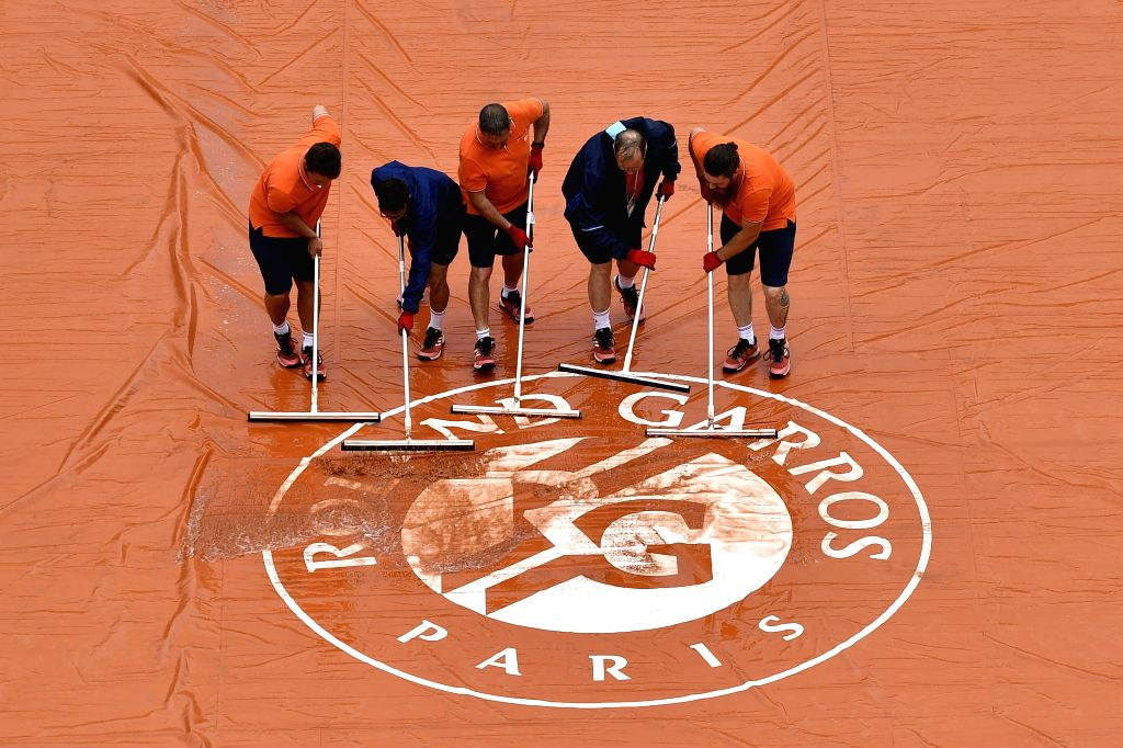 PARIS, May 29, 2018 - Groundstaff members work on the court Philippe-Chatrier during the men's singles first round match between Marin Cilic of Croatia and James Duckworth of Australia at the French ...