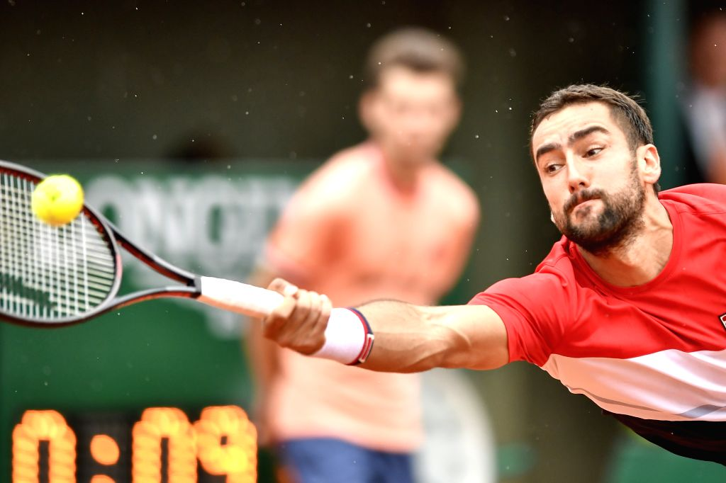 PARIS, May 29, 2018 - Marin Cilic of Croatia returns a shot during the men's singles first round match against James Duckworth of Australia at the French Open Tennis Tournament 2018 in Paris, France ...