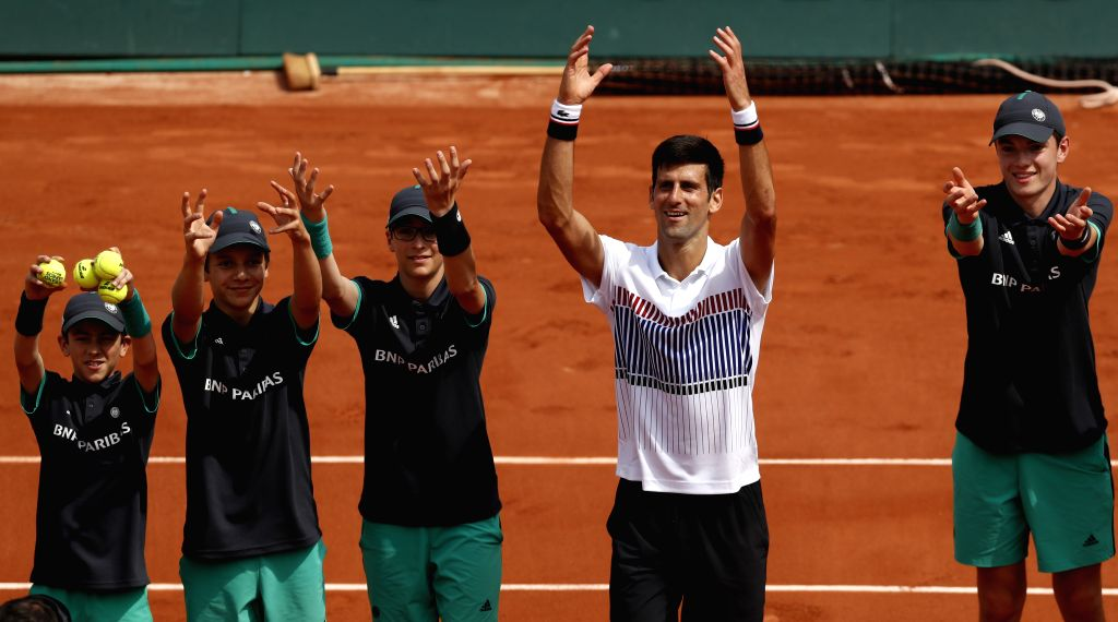PARIS, May 30, 2017 - Novak Djokovic (2nd R) of Serbia celebrates with the ball kids after winning the men's singles first round match against Marcel Granollers of Spain at French Open Tennis ...