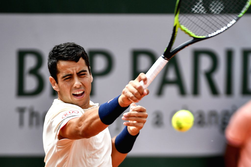 PARIS, May 30, 2018 (Xinhua) -- Jaume Munar of Spain hits a return during the men's singles second round match against Novak Djokovic of Serbia at the French Open Tennis Tournament 2018 in Paris, France on May 30, 2018. Jaume Munar lost by 0-3. (Xinh