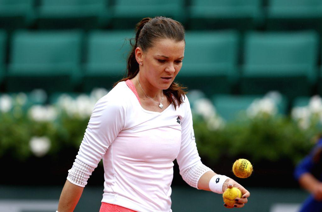 PARIS, May 31, 2016 - Agnieszka Radwanska of Poland reacts during the women's singles fourth round match against Tsvetana Pironkova of Bulgaria at the French Open tennis tournament at Roland Garros ...