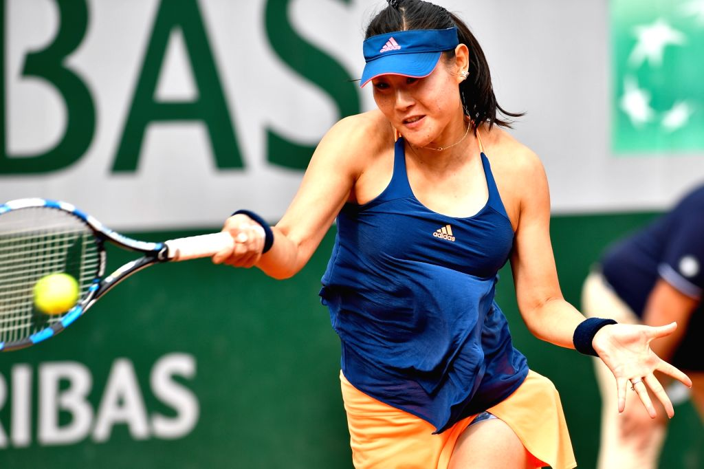 PARIS, May 31, 2017 - Duan Yingying of China returns the ball to Tatjana Maria of Germany during their women's singles 1st round match at French Open Tennis Tournament 2017 in Paris, France on May ...