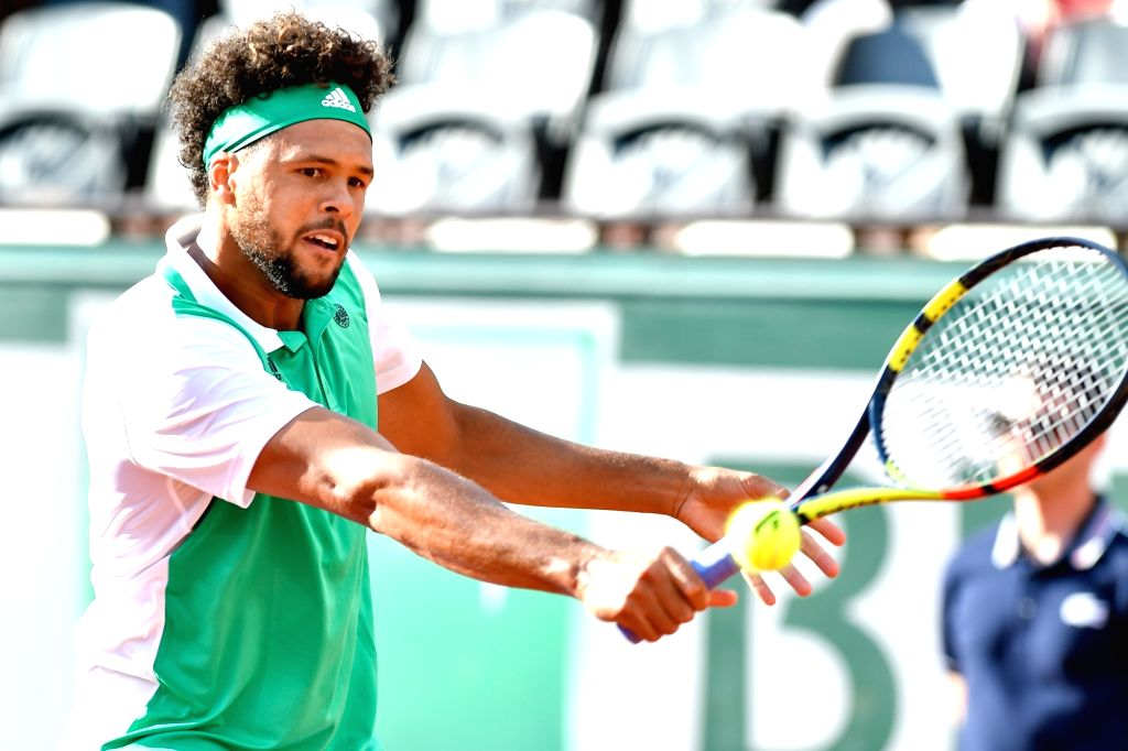 PARIS, May 31, 2017 - Jo-Wilfried Tsonga of France returns the ball to Renzo Olivo of Argentina during the men's singles first round match at the French Open Tennis Tournament 2017 in Paris, France ...