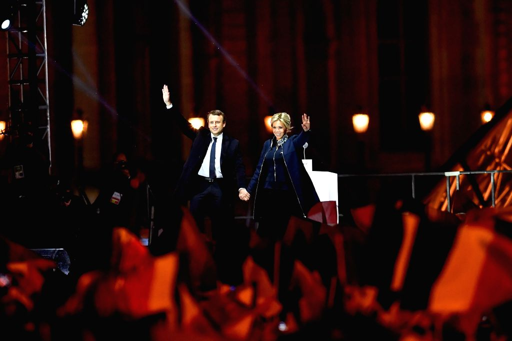 PARIS, May 7, 2017 - Emmanuel Macron and his wife Brigitte Trogneux greet supporters in front of the Louvre Museum in Paris, France, on May 7, 2017. Centrist candidate Emmanuel Macron won Sunday's ...
