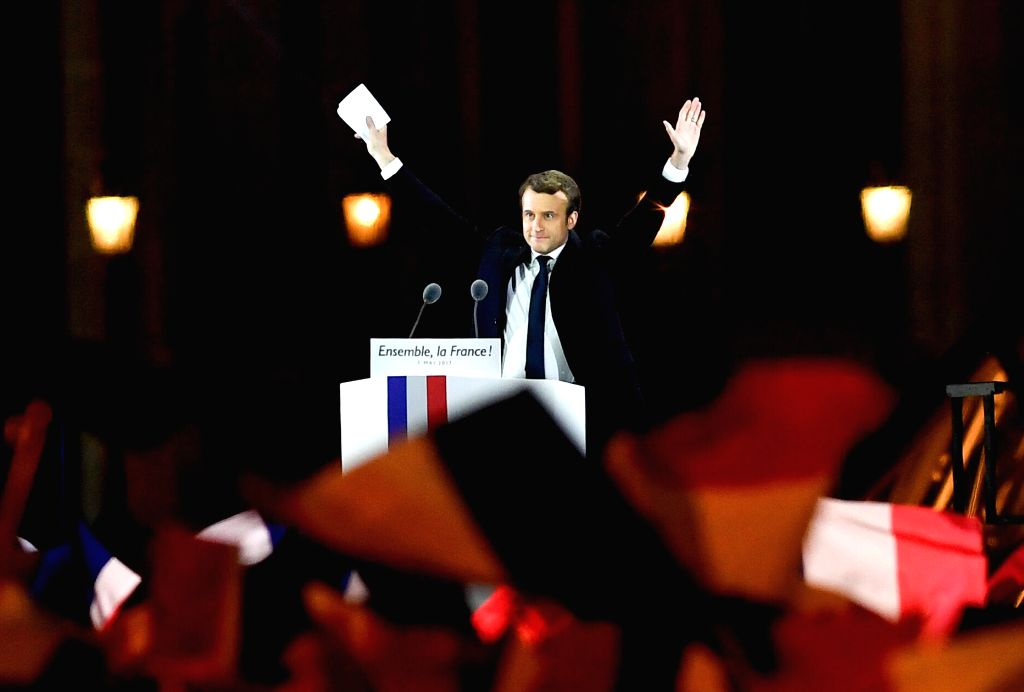 PARIS, May 7, 2017 - Emmanuel Macron greets supporters in front of the Louvre Museum in Paris, France, on May 7, 2017. Centrist candidate Emmanuel Macron won Sunday's runoff vote of the French ...