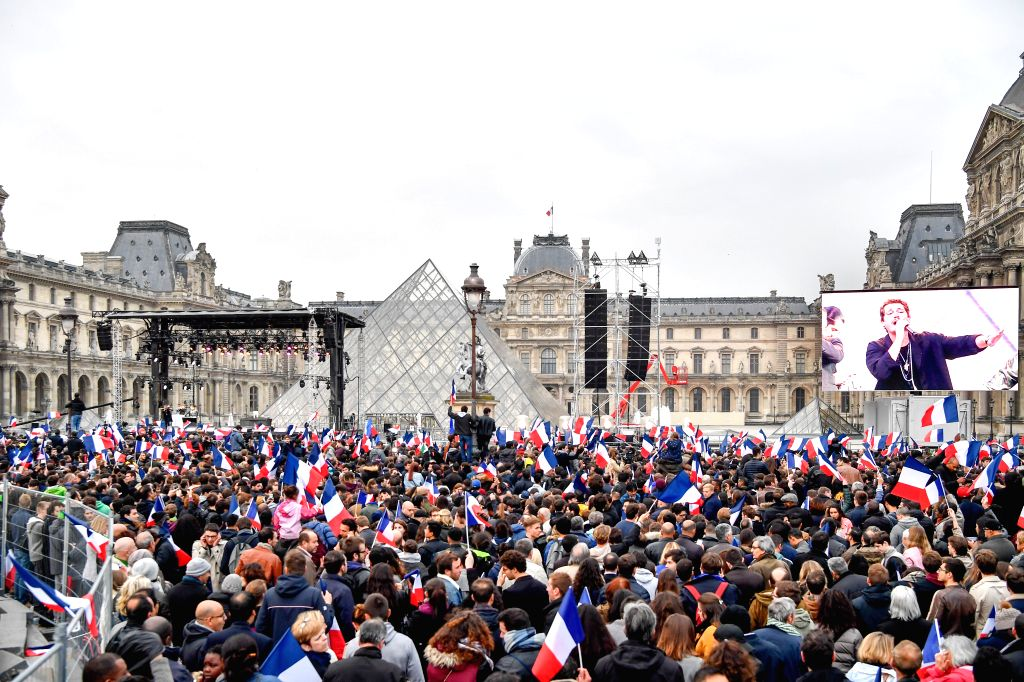 PARIS, May 7, 2017 - People celebrate after an estimation showed that Macron won the presidential race in front of the Louvre Museum in Paris, France, on May 7, 2017. Centrist candidate Emmanuel ...