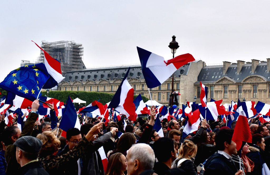 PARIS, May 7, 2017 - People gather to watch a live of French Presidential election in Paris, France, on May 7, 2017. Centrist candidate Emmanuel Macron won Sunday's runoff vote of the French ...