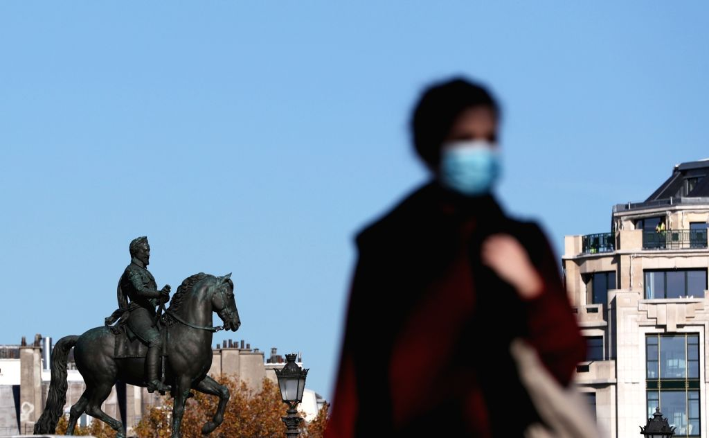 Paris, Nov. 14  A woman walks on the street in Paris, France, Nov. 14, 2020.