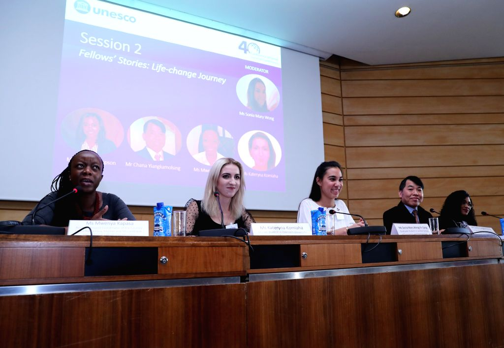PARIS, Nov. 15, 2019 - Recipients of the Great Wall Fellowships share studying experiences in China during a ceremony at the UNESCO headquarters in Paris, France, Nov. 13, 2019. China and the UNESCO ...