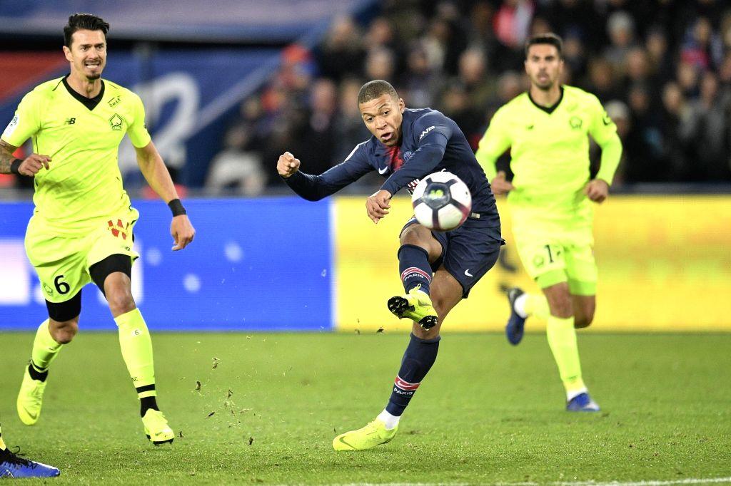 PARIS, Nov. 3, 2018 - Kylian Mbappe (C) of Paris Saint-Germain shoots during the French Ligue 1 soccer match between Paris Saint-Germain and Lille in Paris, France on Nov. 2, 2018. Paris ...