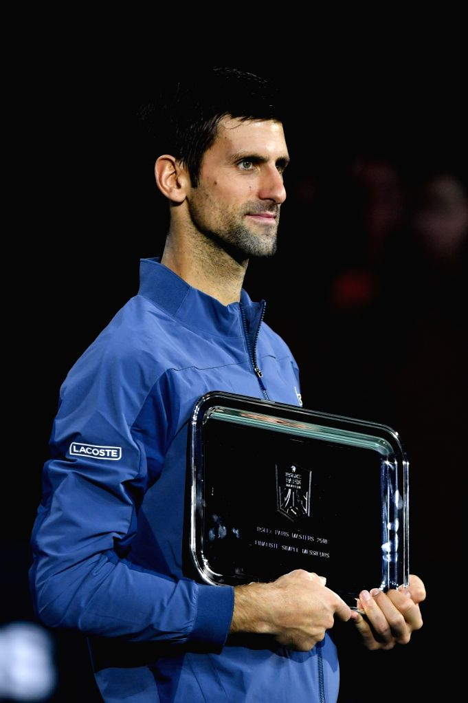 PARIS, Nov. 5, 2018 - Novak Djokovic of Serbia poses for photos during the awarding ceremony after the singles final against Karen Khachanov of Russia at ATP Paris Masters in Paris, France on Nov. 4, ...