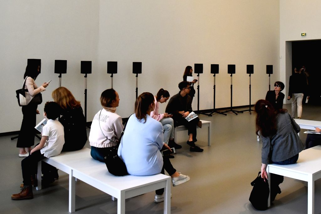 "PARIS, Oct. 10, 2017 - Visitors stand or sit by an acoustic art installation during a media preview for the exhibition ""Being Modern: MoMA in Paris"" at Foundation Louis Vuitton in Paris, ..."