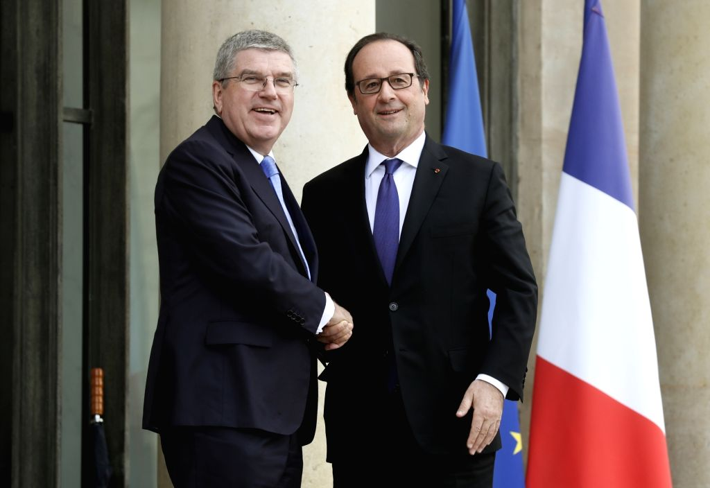 PARIS, Oct. 3, 2016 - International Olympic Committee (IOC) president Thomas Bach (L) is welcomed by French President Francois Hollande at the Elysee Palace in Paris, France, on Oct. 2, 2016. Paris ...