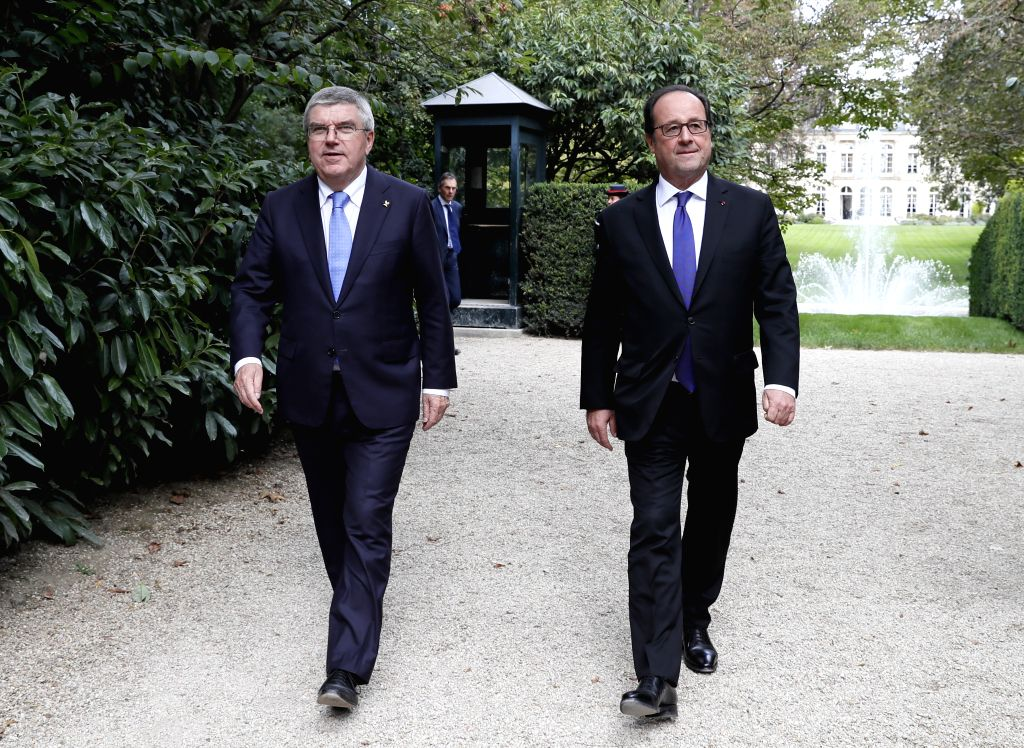 PARIS, Oct. 3, 2016 - International Olympic Committee President Thomas Bach (L) and French President Francois Hollande leave from the Elysee Palace in Paris, France, on Oct. 2, 2016. Paris is ...