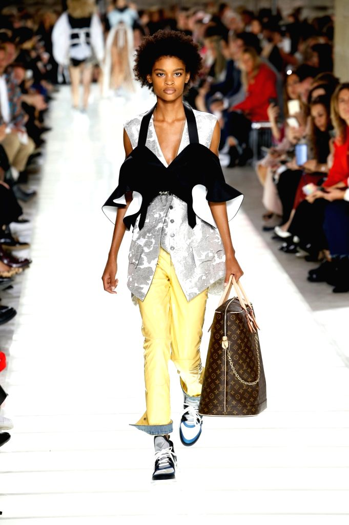 PARIS, Oct. 3, 2017 - A model presents a creation of Louis Vuitton during the fashion week for 2018 spring/summer women's collection in Paris, France, on Oct. 3, 2017.