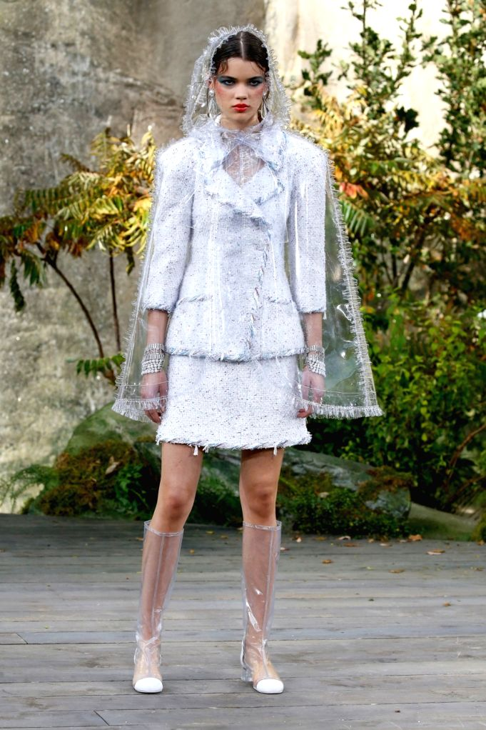 PARIS, Oct. 3, 2017 - A model presents a creation of Chanel during the fashion week for 2018 spring/summer women's collection in Paris, France, on Oct. 3, 2017.
