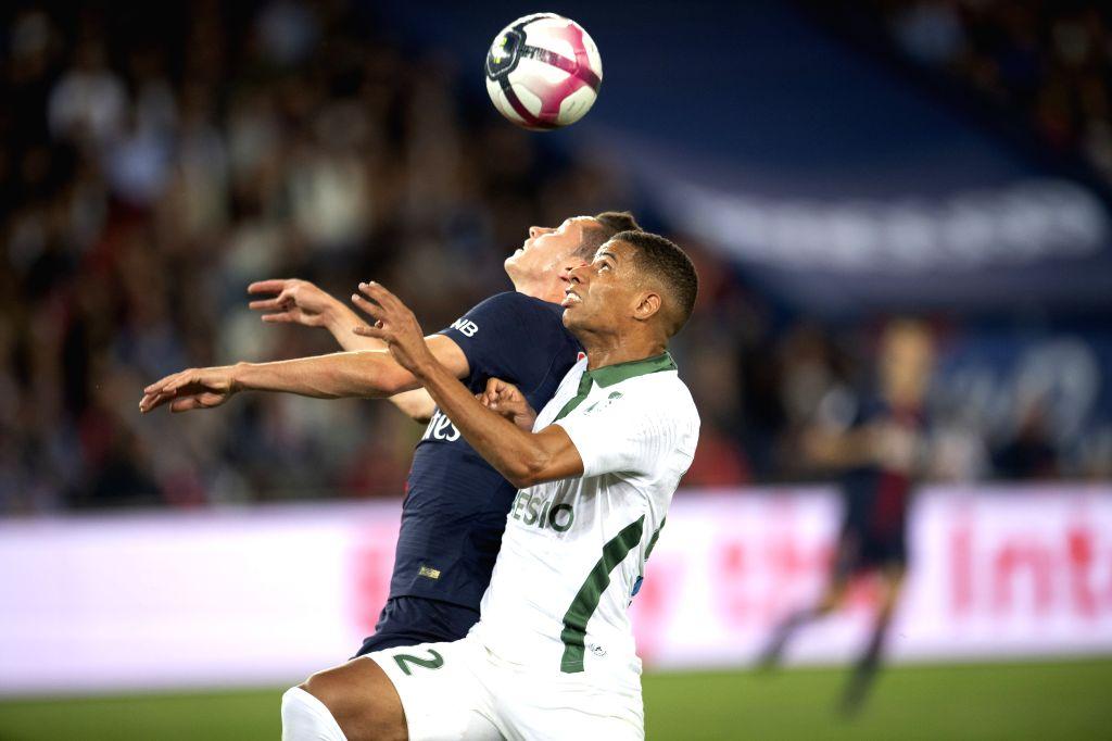 PARIS, Sept. 15, 2018 - Julian Draxler (L) of Paris Saint-Germain vies with Kevin Monnet-Paquet of Saint-Etienne during their match of French Ligue 1 2018-2019 season 5th round in Paris, France on ...