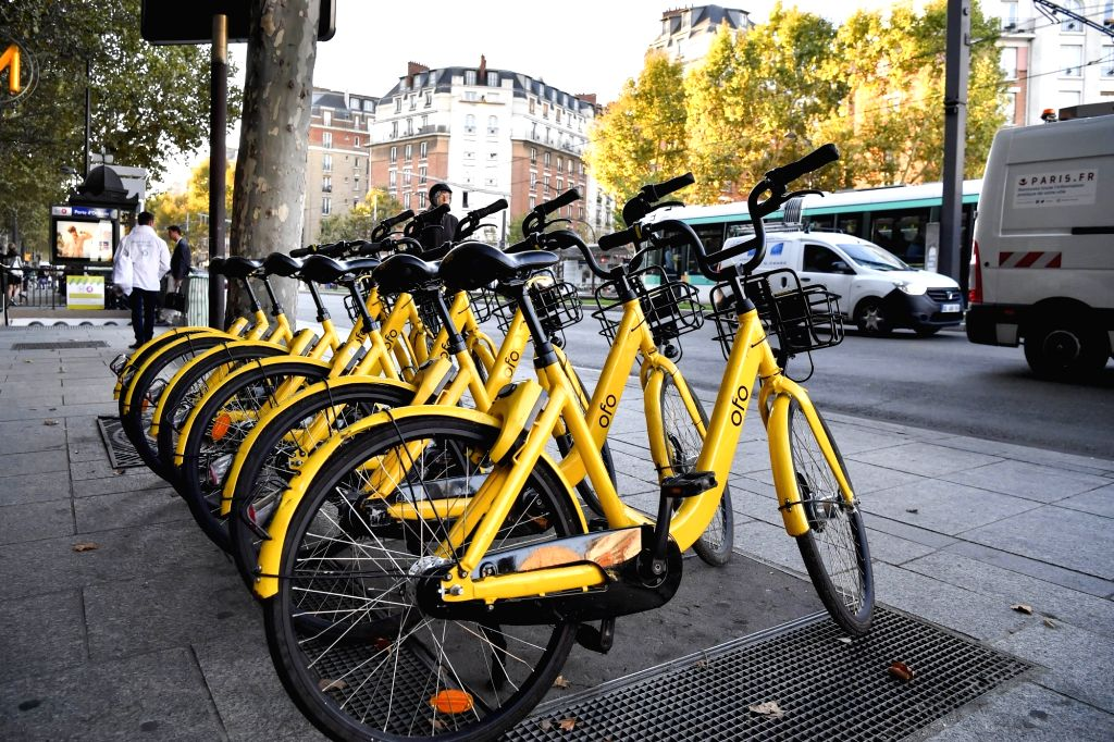 """PARIS, Sept. 17, 2018 - Photo taken on Sept. 17, 2018 shows ofo shared bikes at the station of """"Porte d'Orleans"""" in Paris, France. On the occasion of the European Mobility Week, ofo ..."""