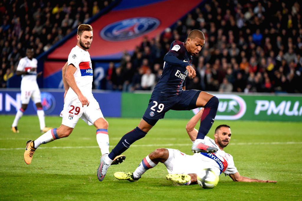PARIS, Sept. 18, 2017 - Kylian Mbappe (C) of Paris Saint Germain competes with Lucas Tousart (L) and Jeremy Morel of Lyon during their match of French Ligue 1 in Paris, France on Sept. 17, 2017. ...