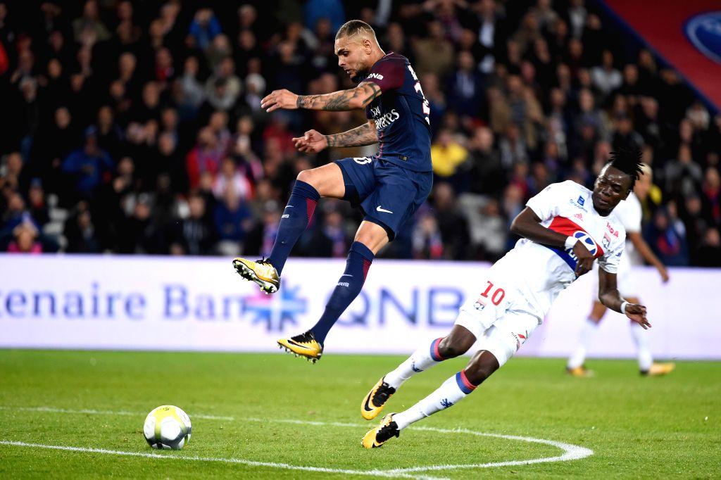 PARIS, Sept. 18, 2017 - Layvin Kurzawa (L) of Paris Saint Germain competes with Bertrand Traore of Lyon during their match of French Ligue 1 in Paris, France on Sept. 17, 2017. Paris Saint Germain ...