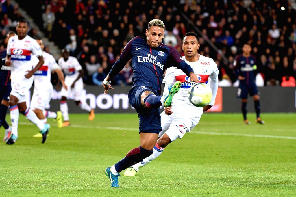 PARIS, Sept. 18, 2017 - Neymar (L) of Paris Saint Germain competes with Kenny Tete of Lyon during their match of French Ligue 1 in Paris, France on Sept. 17, 2017. Paris Saint Germain won 2-0. ...