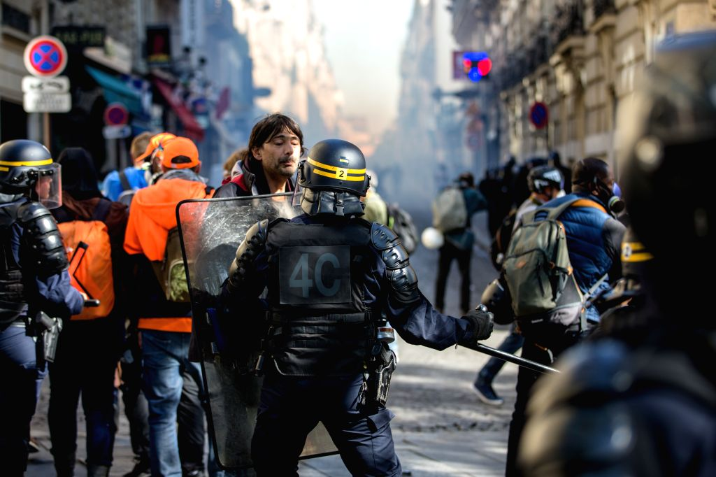 PARIS, Sept. 21, 2019 - A demonstrator faces police officers on the Champs Elysees in Paris, France, Sept. 21, 2019. French police had arrested 137 individuals in Paris by 16:00 local time (1400 ...