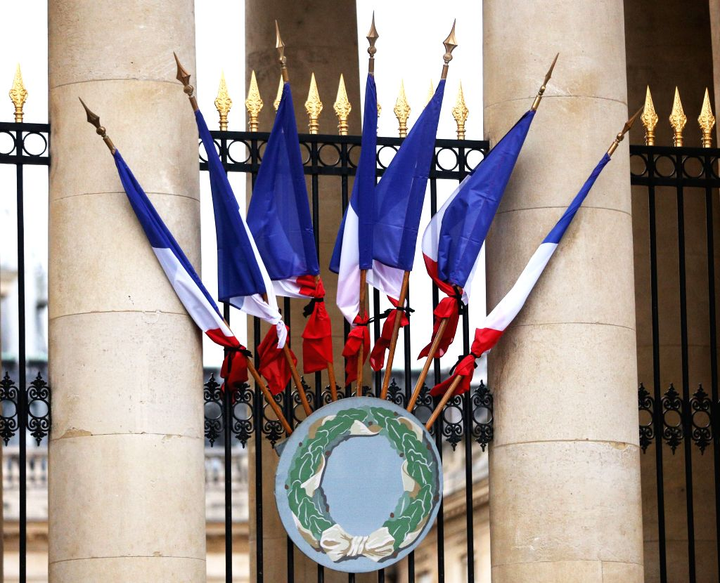 PARIS, Sept. 26, 2019 - French national flags with black ribbons are seen at the National Assembly to mourn late former French President Jacques Chirac in Paris, France, on Sept. 26, 2019. France's ...