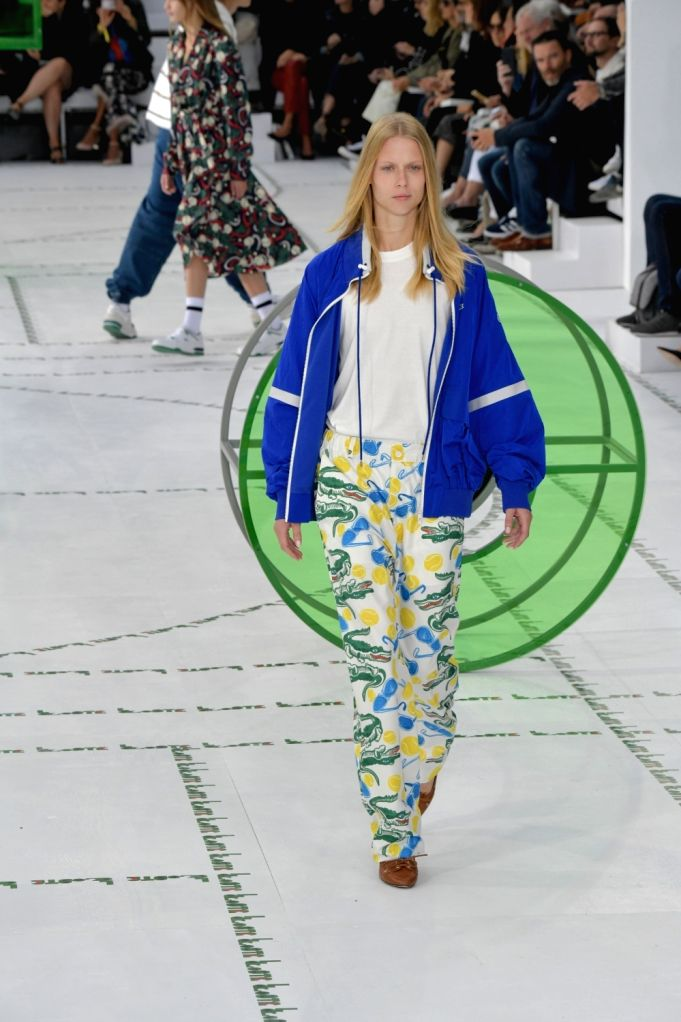 PARIS, Sept. 28, 2017 - A model presents a creation of Lacoste during the fashion week for 2018 spring/summer women's collection in Paris, France, on Sept. 27, 2017.