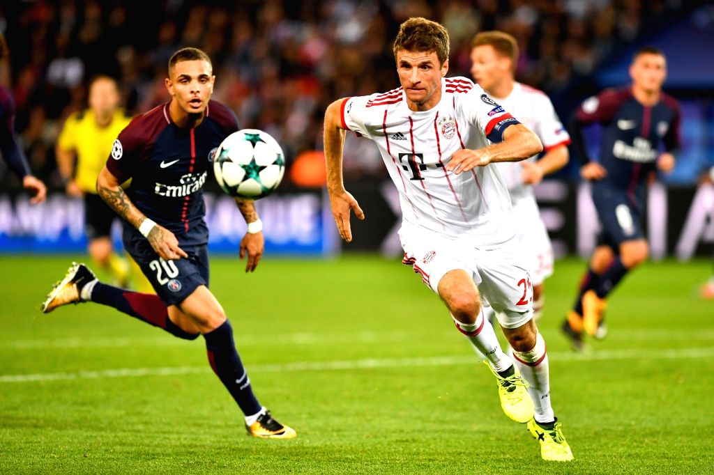 PARIS, Sept. 28, 2017 - Layvin Kurzawa (L) from Paris Saint-Germain competes with Thomas Muller from Bayern Munich during their match of Group B of the 2017-18 season Champions League at Parc des ...