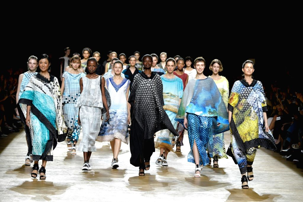 PARIS, Sept. 29, 2017 - Models present creations of Issey Miyake during the fashion week for 2018 spring/summer women's collection in Paris, France, on Sept. 29, 2017.