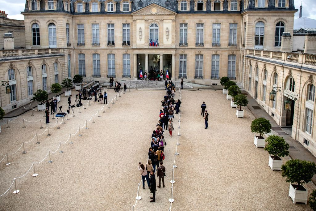 PARIS, Sept. 29, 2019 - People wait for signing condolence registers at the Elysee Presidential Palace, following the death of former French President Jacques Chirac in Paris, France, Sept. 28, 2019. ...
