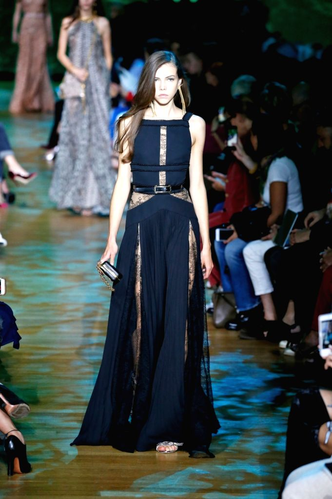 PARIS, Sept. 30, 2017 - A model presents a creation of Elie Saab during the fashion week for 2018 Spring/Summer women's collection in Paris, France, on Sept. 30, 2017.