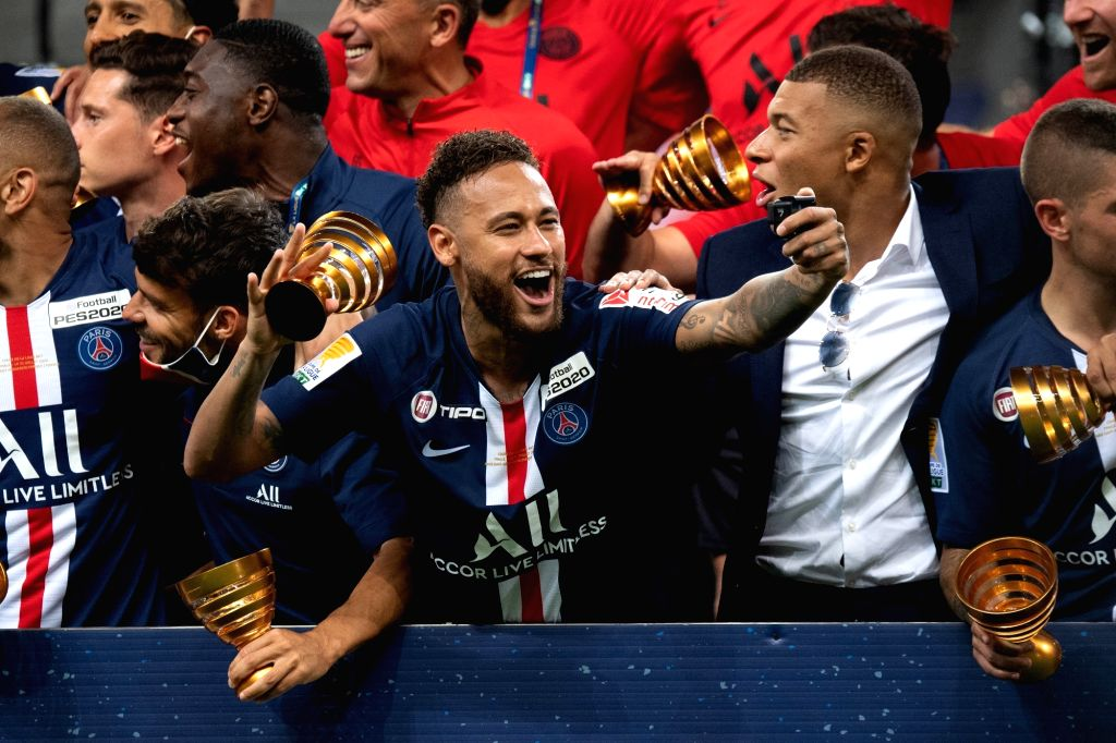 Paris St Germain's Neymar celebrates with Kylian Mbappe after winning the Coupe de la Ligue during final between Olympique Lyonnais and Paris Saint Germain at Stade ...