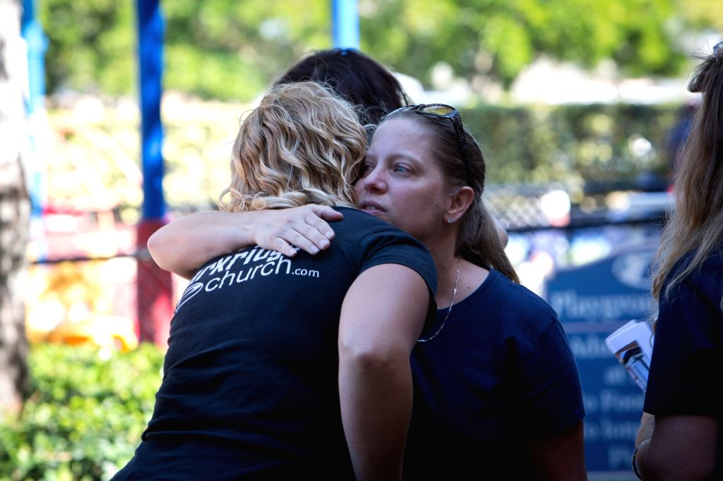PARKLAND (U.S.), Feb. 15, 2018 Community members share an emotional moment during a daytime prayer vigil at Parkridge Church in Parkland, Florida, the United States, on Feb. 15, 2018. A ...