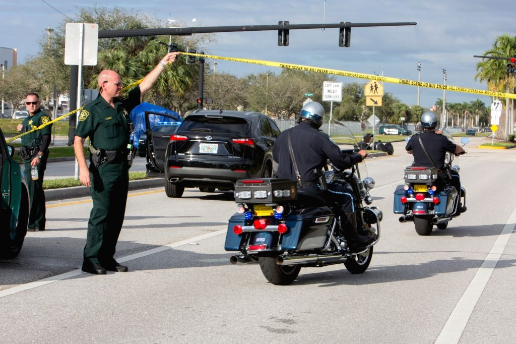 PARKLAND (U.S.), Feb. 15, 2018 Police officers stand guard near Marjory Stoneman Douglas High School in Parkland, Broward County, Florida, the United States, on Feb. 15, 2018. 17 people ...