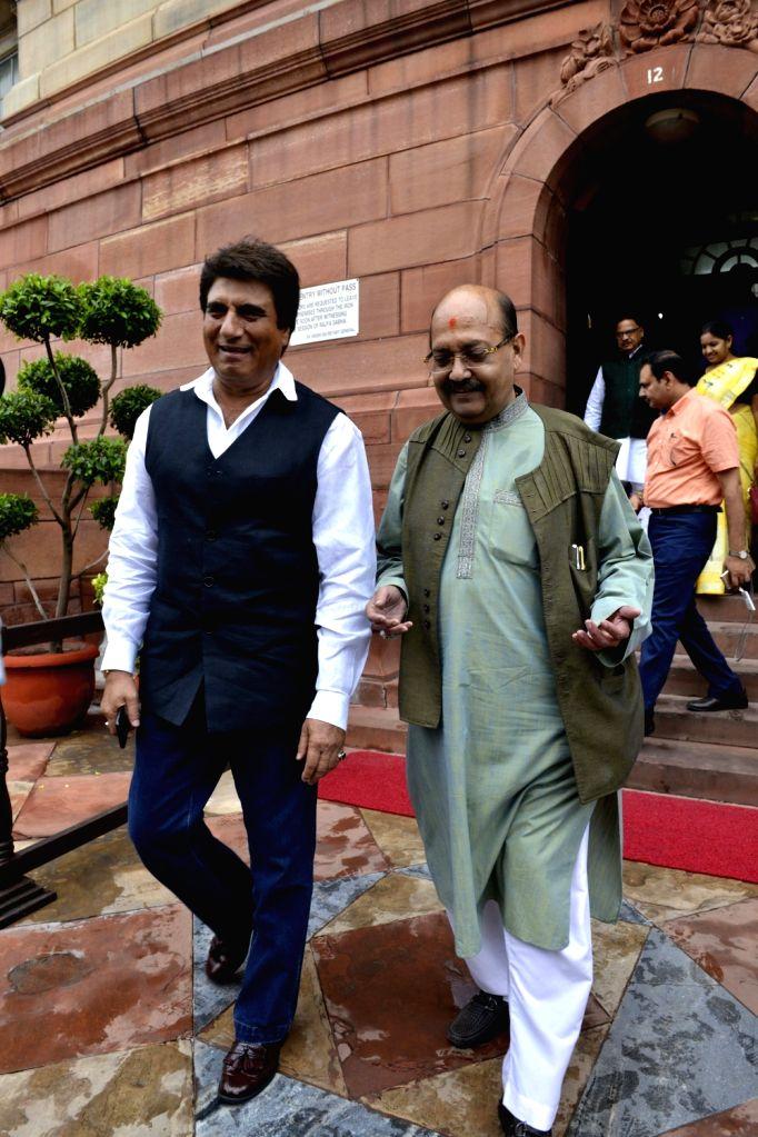 Parliament- Rajya Sabha MPs Amar Singh and Raj Babbar at Parliament in New Delhi on Aug 9, 2017. - Amar Singh