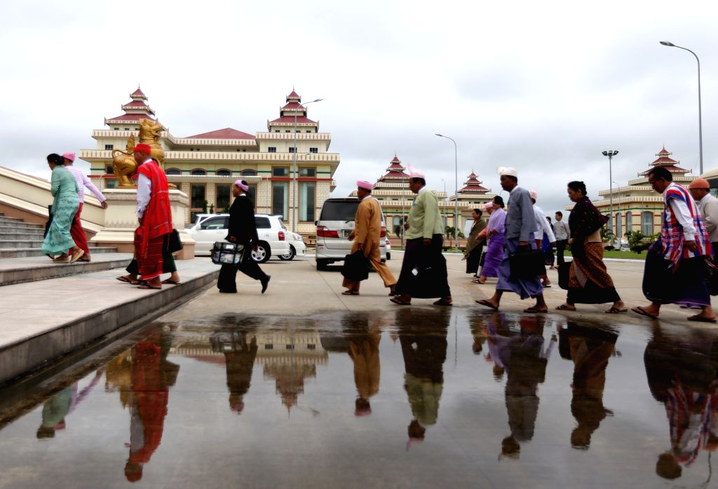 Parliament representatives arrive at the parliament to attend the 12th regular session of the House of Representatives (Lower House) in Nay Pyi Taw, Myanmar, ...