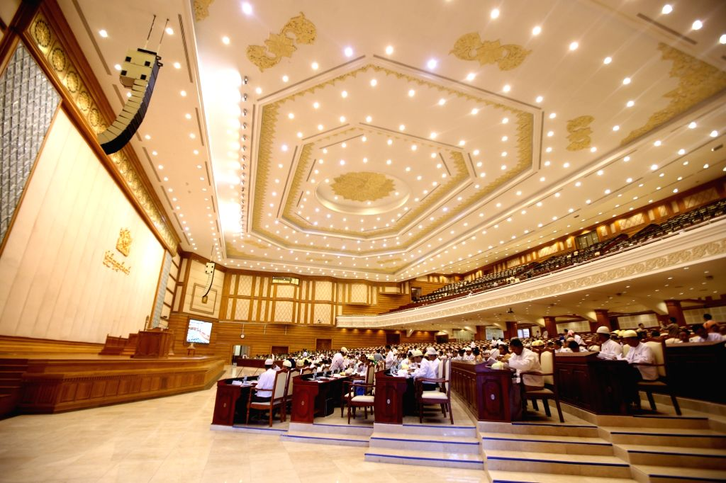 Parliament representatives attend the 13th regular session of the House of Representatives (Lower House) in Nay Pyi Taw, Myanmar, Nov. 16, 2015. Myanmar's two ...