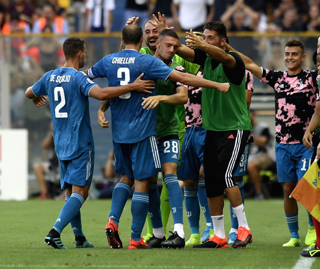 PARMA, Aug. 25, 2019 - Juventus' Giorgio Chiellini (2nd L) celebrates his goal with teammates during the Serie A soccer match between Parma and FC Juventus in Parma, Italy, Aug 24, 2019.
