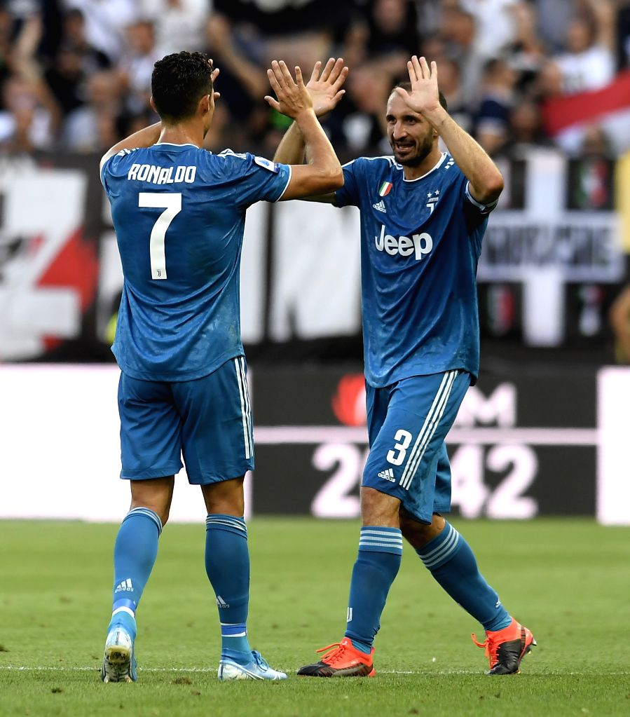 PARMA, Aug. 25, 2019 - Juventus' Giorgio Chiellini (R) celebrates his goal with Cristiano Ronaldo during the Serie A soccer match between Parma and FC Juventus in Parma, Italy, Aug 24, 2019.