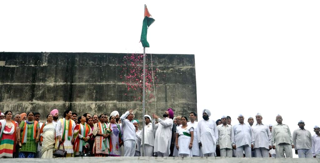 Partap Singh Bajwa, President Punjab Congress hoisting the national flag on the Independence Day at Punjab Congress Bhawan, Chandigarh on August 15, 2013. (Photo::: IANS)
