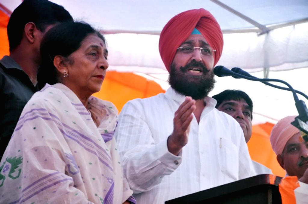 Partap Singh Bajwa, president Punjab Congress at a rally with Union Minister of State for Health Santosh Chaudhary in Hoshiarpur, Punjab on August 16, 2013. (Photo::: IANS)