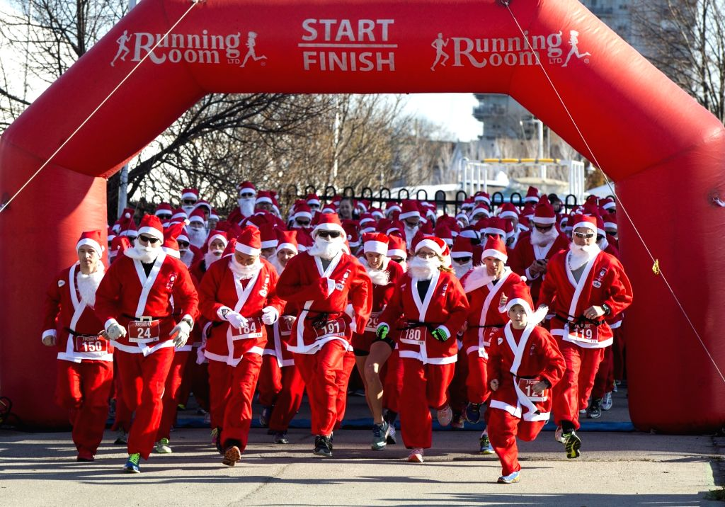 Participants dressed as Santa Claus take part in the 2015 Santa 5K Run in Hamilton, Ontario, Canada, Nov. 15, 2015. Hundreds of runners participated in this annual ...