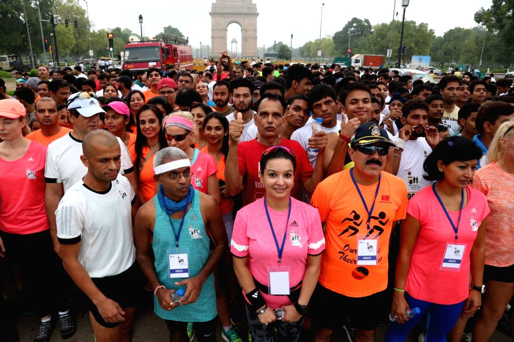 Participants during the 'Great India Run', India's first multi-city marathon at India Gate in New Delhi on July 17, 2016.